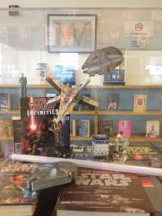 wider shot - paper Millennium Falcon in the background