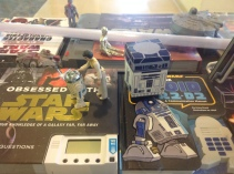 Other side of the display, I re-create the scene with Princess Leia and R2-D2 from A New Hope on the left. On the right is a R2-D2 cubeecraft model. A C-3PO is in the background deactivated.